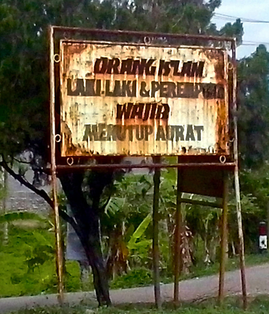 "Public signboards in Aceh saying ""It is compulsory for Muslim Men and Women to cover their Aurat (Arabic for Intimate parts of the body)"