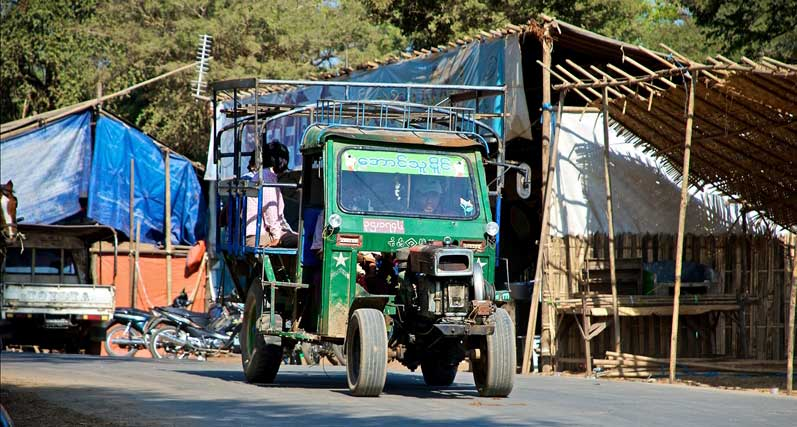 A Myanmar truck transporting goods and people from village to village
