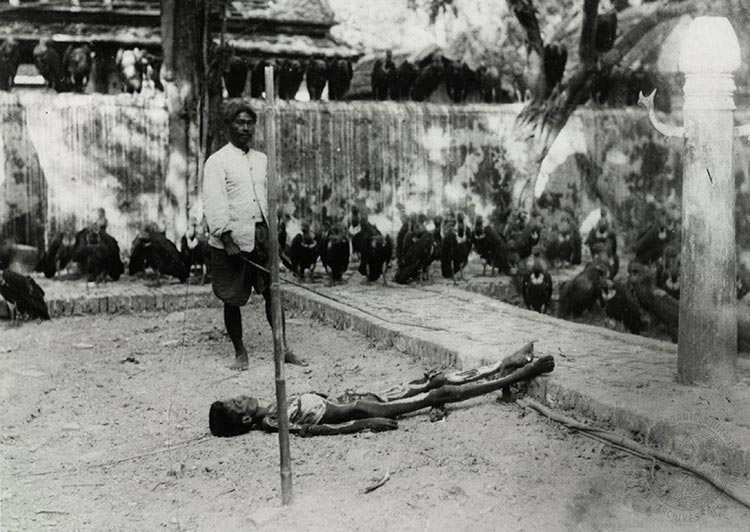 In the era prior to state intervention, unnatural death was a communal concern that required appropriate forms of action to placate the spirit of the deceased.  Here an undertaker (saparue) tends to a corpse as vultures look on.  Image courtesy of the National Archives of Thailand, image # ภอ.ทต.2/33.