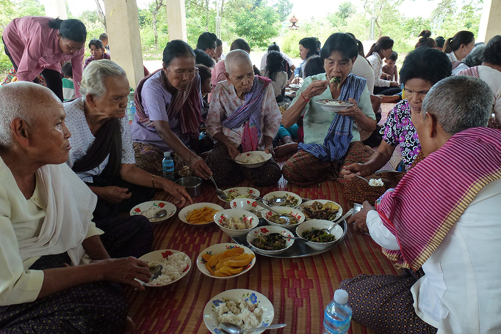 """Meal taken by villagers during the ritual of asking for rain at the Braḥ jī altar, Pursat"" (Photo: Anne Guillou, 2015)"