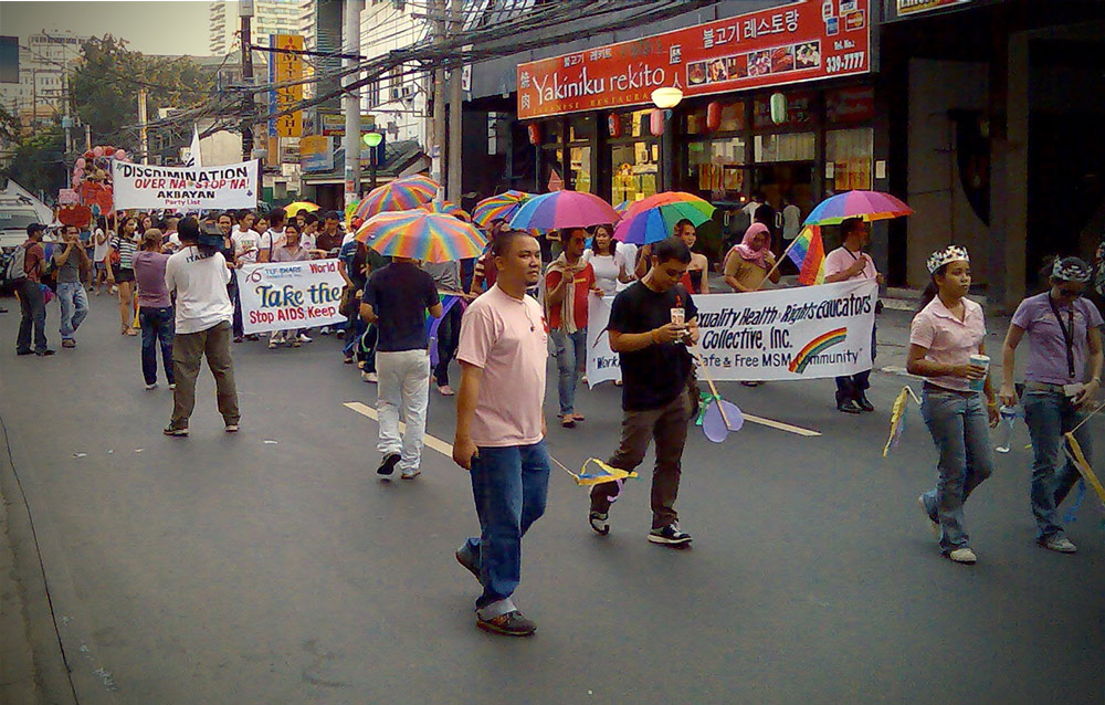 Pride March 2007 in Manila, along Mabini Street. On the foreground wearing pink is Glenn Cruz, development worker and former Executive Director of TLF SHARE Collective, Inc. Photo by DENNIS CORTEZA