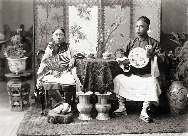 A portrait of a Sino-Burmese merchant and his wife in Rangoon
