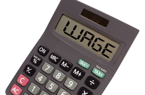 "Old calculator on white background showing text ""wage"" in perspe"