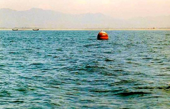 Plate 1: Buoy in the mouth of the river Naf, the southernmost marker of the Burma-Bangladesh boundary. The mountains of Arakan can be seen in the distance. Photograph: Willem van Schendel, 2001.
